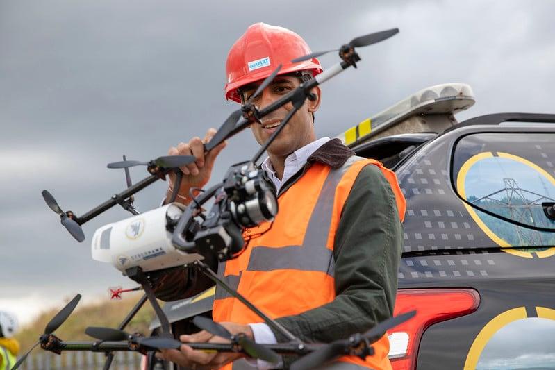 Rishi Sunak holding Cyberhawk drone